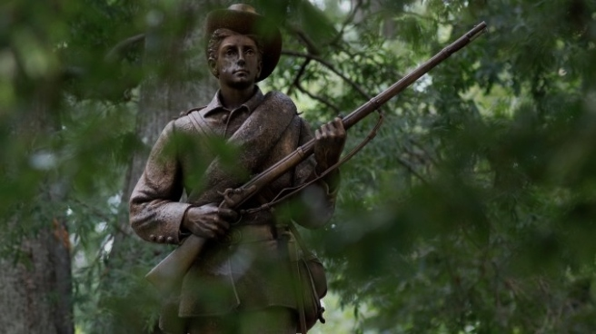 A statue of a Confederate soldier nicknamed Silent Sam stands on the campus of the University of North Carolina in Chapel Hill, North Carolina, U.S. August 17, 2017. REUTERS/Jonathan Drake TPX IMAGES OF THE DAY